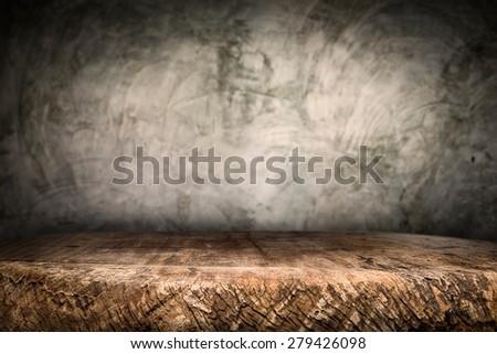 Wooden desk platform and polished concrete surface background - stock photo