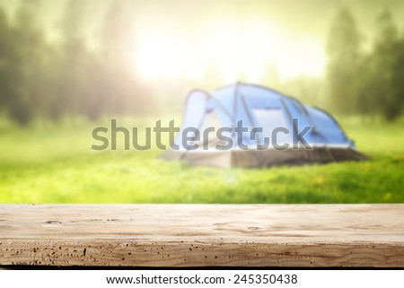 wooden desk space and tent at summer time  - stock photo