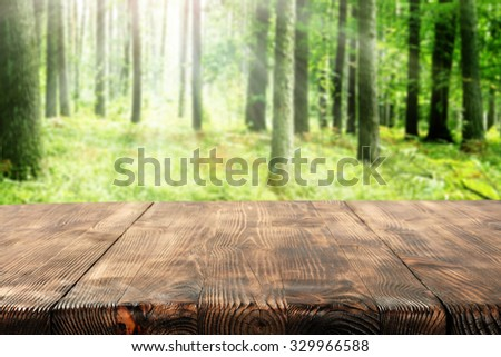wooden desk space green forest space and space for you