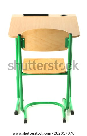 Wooden desk with books and chair isolated on white - stock photo