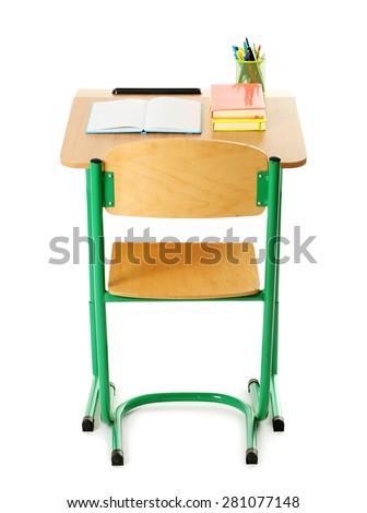 Wooden desk with stationery and chair isolated on white - stock photo