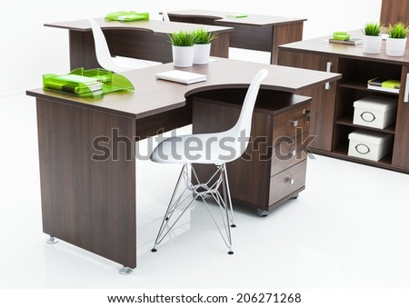 wooden desks and white plastic chairs in the office - stock photo