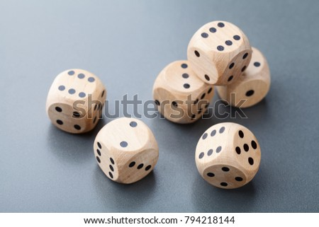 Wooden dice on gray table. Board game. Gambling devices.