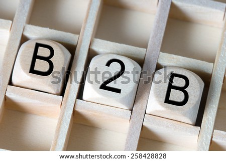 Wooden dice with the abbreviation B2B / B2B - stock photo