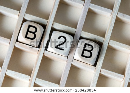 Wooden dice with the abbreviation B2B / B2B