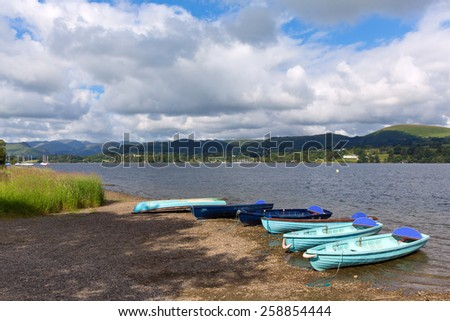 Wooden dinghy rowing boats in the Lake District Ullswater Cumbria England UK - stock photo
