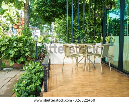 Wooden dining table at balcony in morning time.