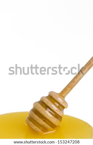 wooden  dipper in a spot of honey