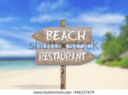 Wooden direction sign beach or restaurant - stock photo