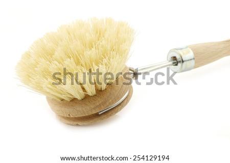 wooden dish washing brush on a white background - stock photo