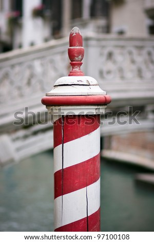 Wooden dock post painted with red and white stripes - Venice, Venezia, Italy, Europe - stock photo