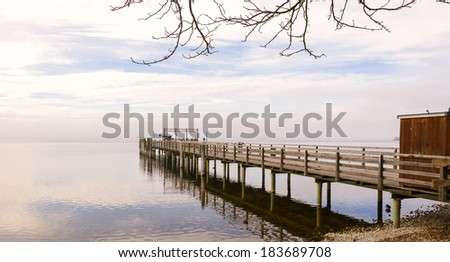 Wooden Dock with Birds during Winter Season  - stock photo