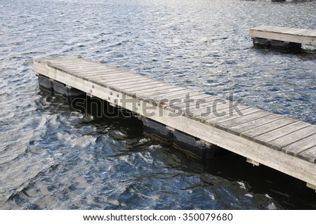 Wooden docks in a lake - stock photo