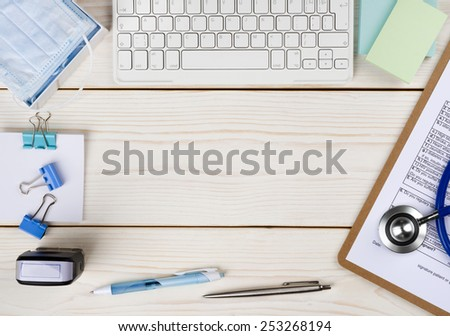 Wooden doctor desk with copy space in the middle - stock photo