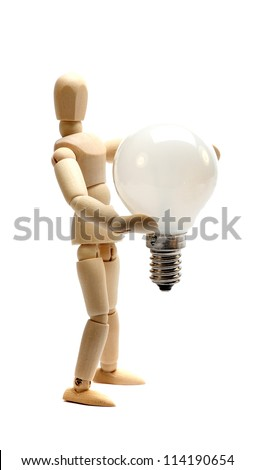 wooden doll holding a light bulb - stock photo