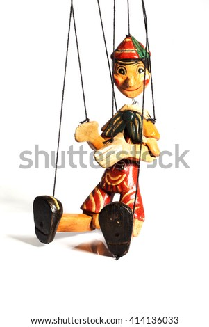 Wooden doll marionette of Pinocchio liar with big nose isolated on background