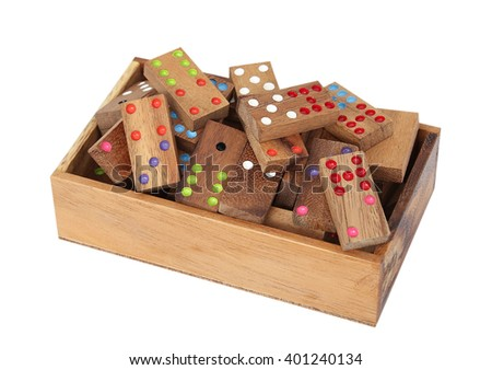 Wooden dominoes in a wooden box, isolated - stock photo