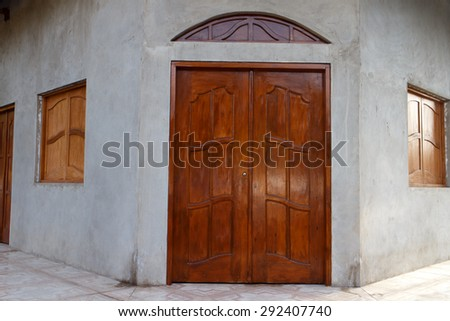 wooden door and window at entry of house