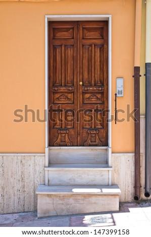 Wooden door. Biccari. Puglia. Italy. - stock photo