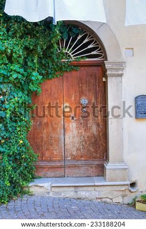 Wooden door. Cancellara. Basilicata. Italy. - stock photo