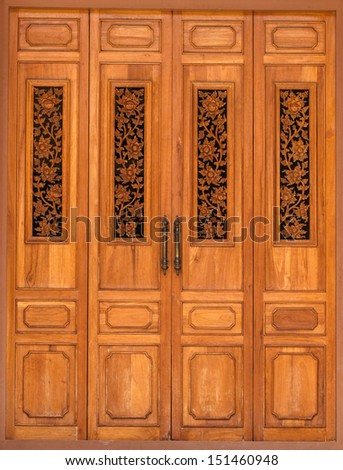 Wooden Door decorated with Floral Wood Carvings - stock photo