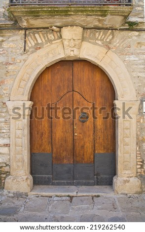 Wooden door. Guardia Perticara. Basilicata. Italy. - stock photo