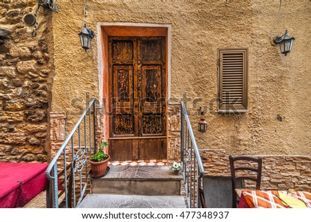 wooden door in a picturesque corner in Sardinia, Italy