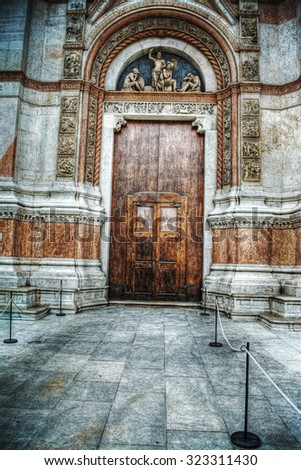 wooden door in San Petronio cathedral in Bologna, Italy - stock photo