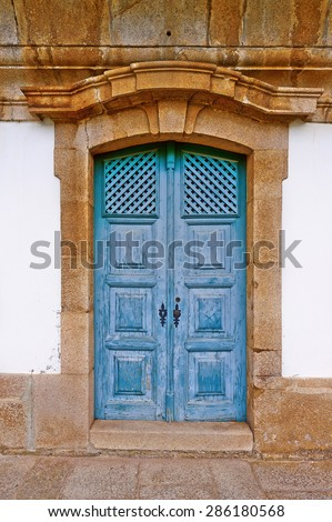 Wooden Door in the Wall of Portuguese Home