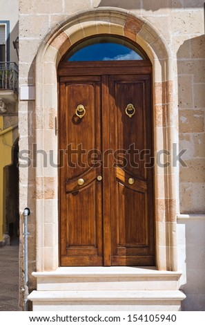Wooden door. Manduria. Puglia. Italy. - stock photo