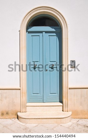 Wooden door. Maruggio. Puglia. Italy. - stock photo