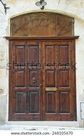 Wooden door. Matera. Basilicata. Italy. - stock photo