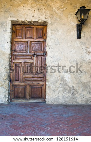 Wooden door of historic mission San Jose in San Antonio - stock photo