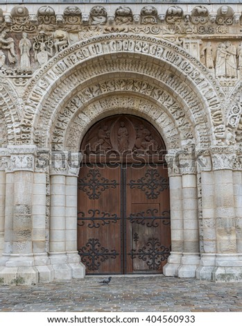 Wooden door of the church of Poitiers in France.
