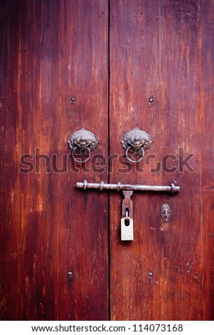Wooden door with ancient - stock photo