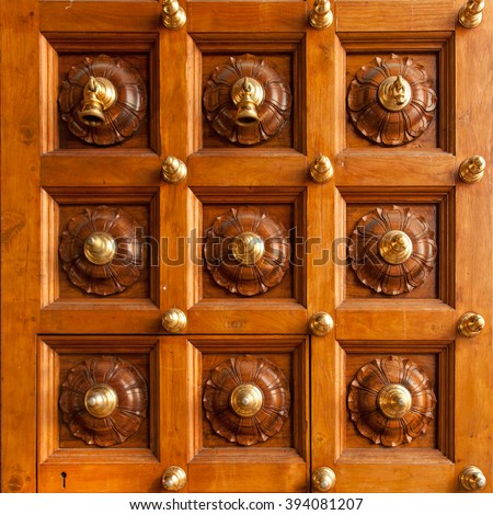 Wooden door with bells in Sri Mariamman Temple. Singapore, China Town