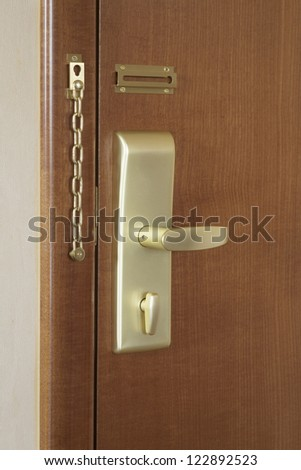 Wooden door with handle and lock