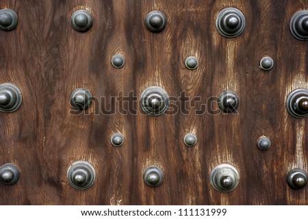 wooden door with metal ornaments & Wooden Door Metal Ornaments Stock Photo (Royalty Free) 111131999 ...
