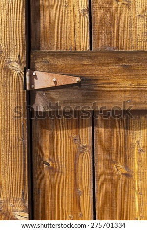 Wooden door with rusty hinges, high resolution texture background image