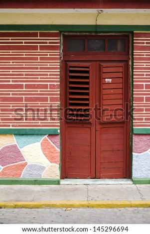 wooden door with shaders in Mexico