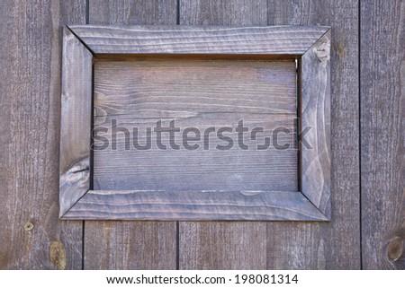 Wooden door with window, close-up - stock photo