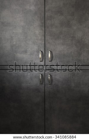 Wooden doors background with  handles, natural light - stock photo