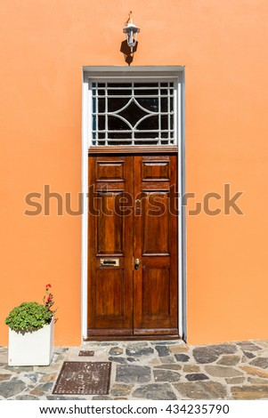 Wooden Doors On A Peach Wall In Cape Town, South Africa