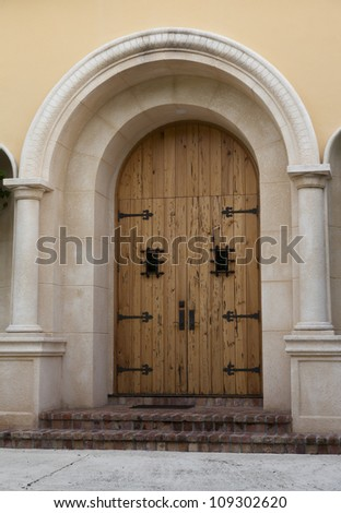 Wooden doors with arch.
