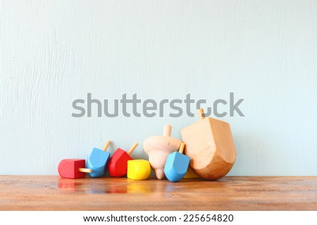 wooden dreidels for hanukkah (spinning top) over the table - stock photo