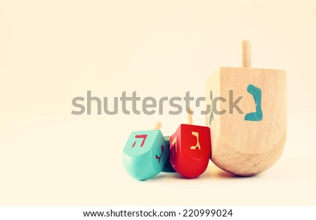 wooden dreidels (spining top)  for hanukkah jewish holiday . filtered image - stock photo
