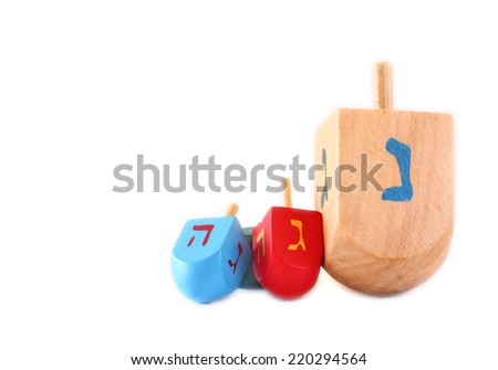 wooden dreidels (spinning top) for hanukkah jewish holiday isolated on white - stock photo