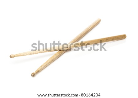 Wooden drum sticks against a white background - stock photo