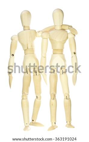 Wooden dummies - hug (isolated on white background) - stock photo