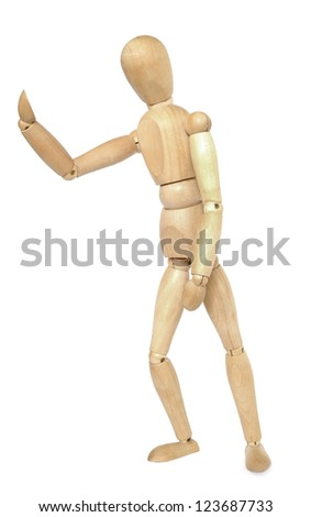 Wooden dummy pushing. Isolated on a white background.